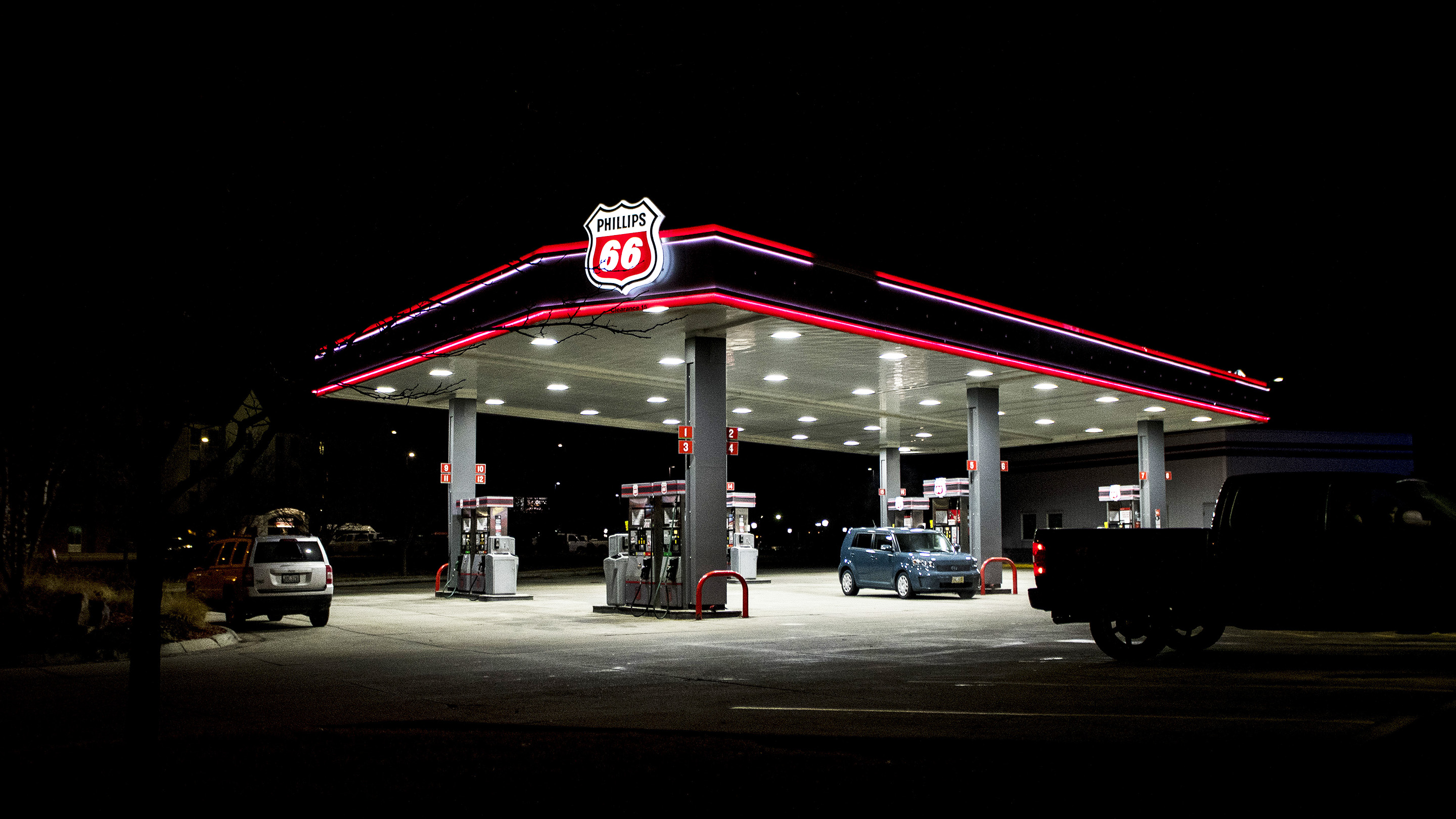 A Phillips 66 gas station stands illuminated at night in Omaha, Nebraska, U.S., on Sunday Jan. 29, 2017. Phillips 66 is scheduled to release earnings figures on February 3. Photographer: Christopher Dilts/Bloomberg via Getty Images